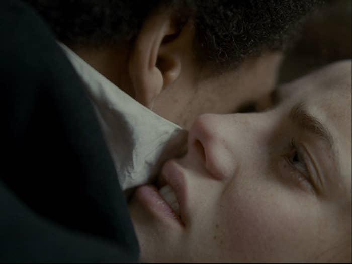 An impassioned woman presses her cheek against a man's cheek