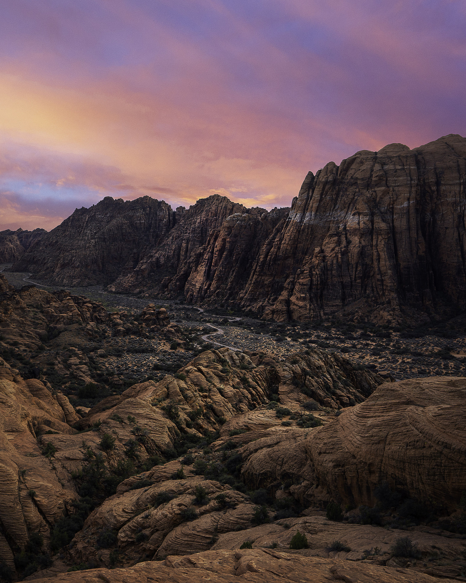 magical pastel colored over dark, rugged rocks at snow canyon state park