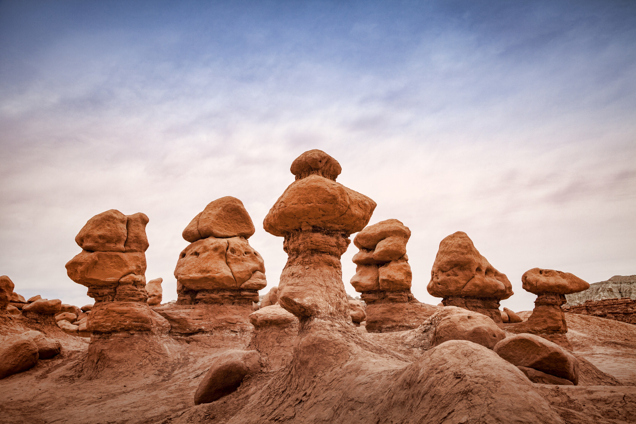 a cluster of Hoodoos — vertical rock formations that look like rocks stacked on top of each other — in Goblin Valley State Park