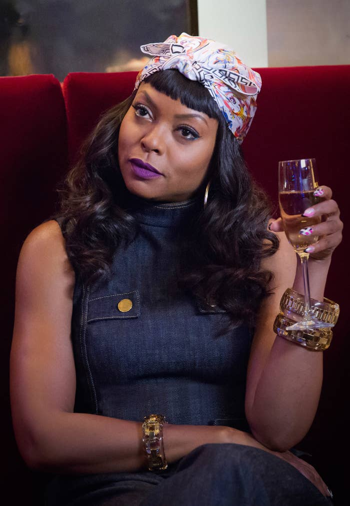 """Taraji P Henson holds a glass of champagne as Cookie Lyon in """"Empire"""""""