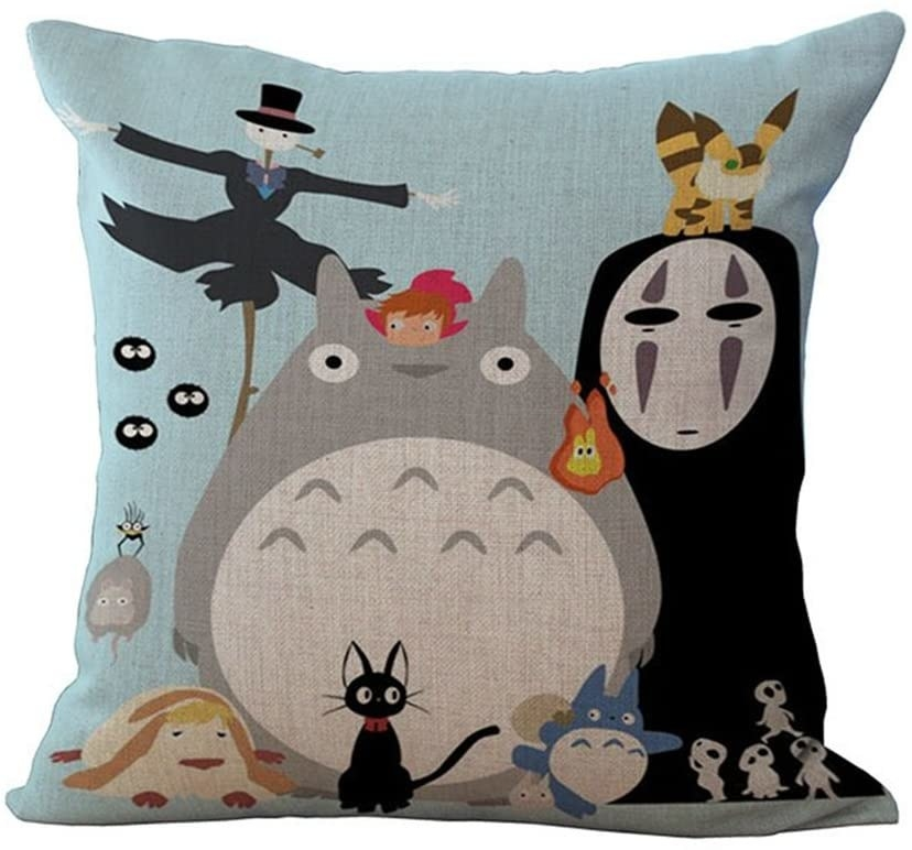A pillow cover with several Studio Ghibli characters printed on it