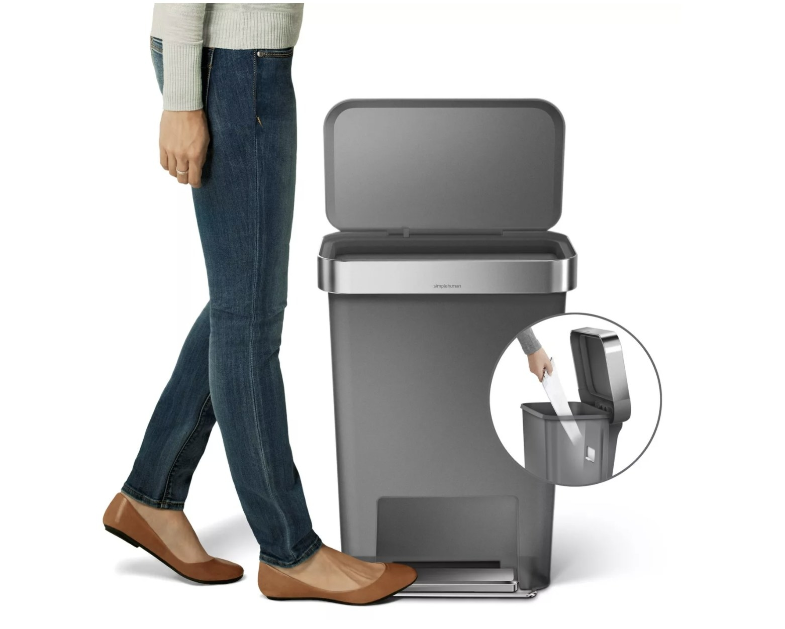 A model stepping on the bin opener foot pedal