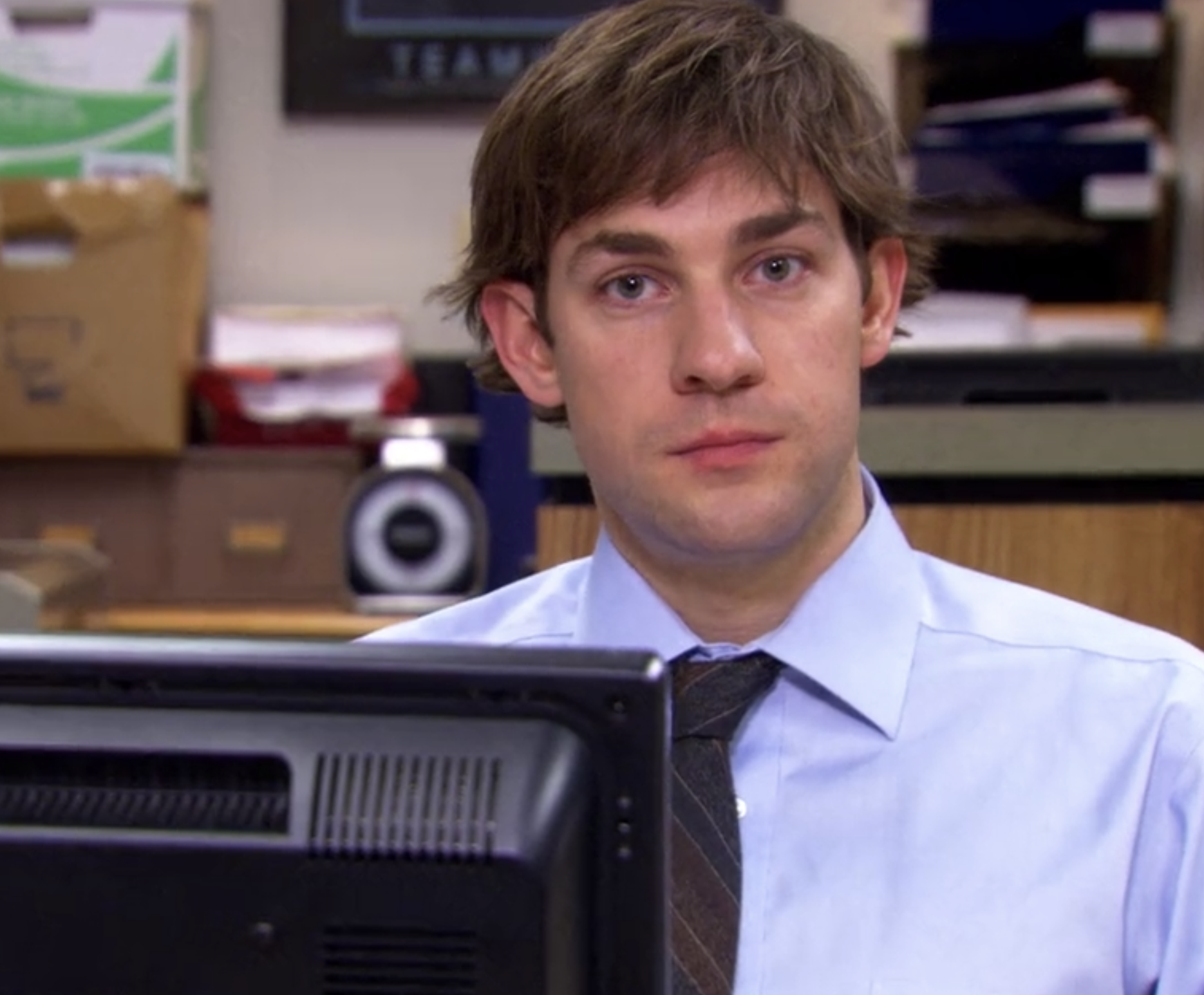 Jim looking at the camera while wearing the wig