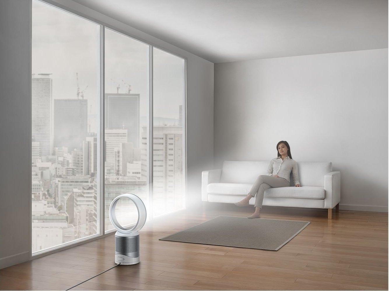 a small, circular fan-less air purifier in the middle of a living room