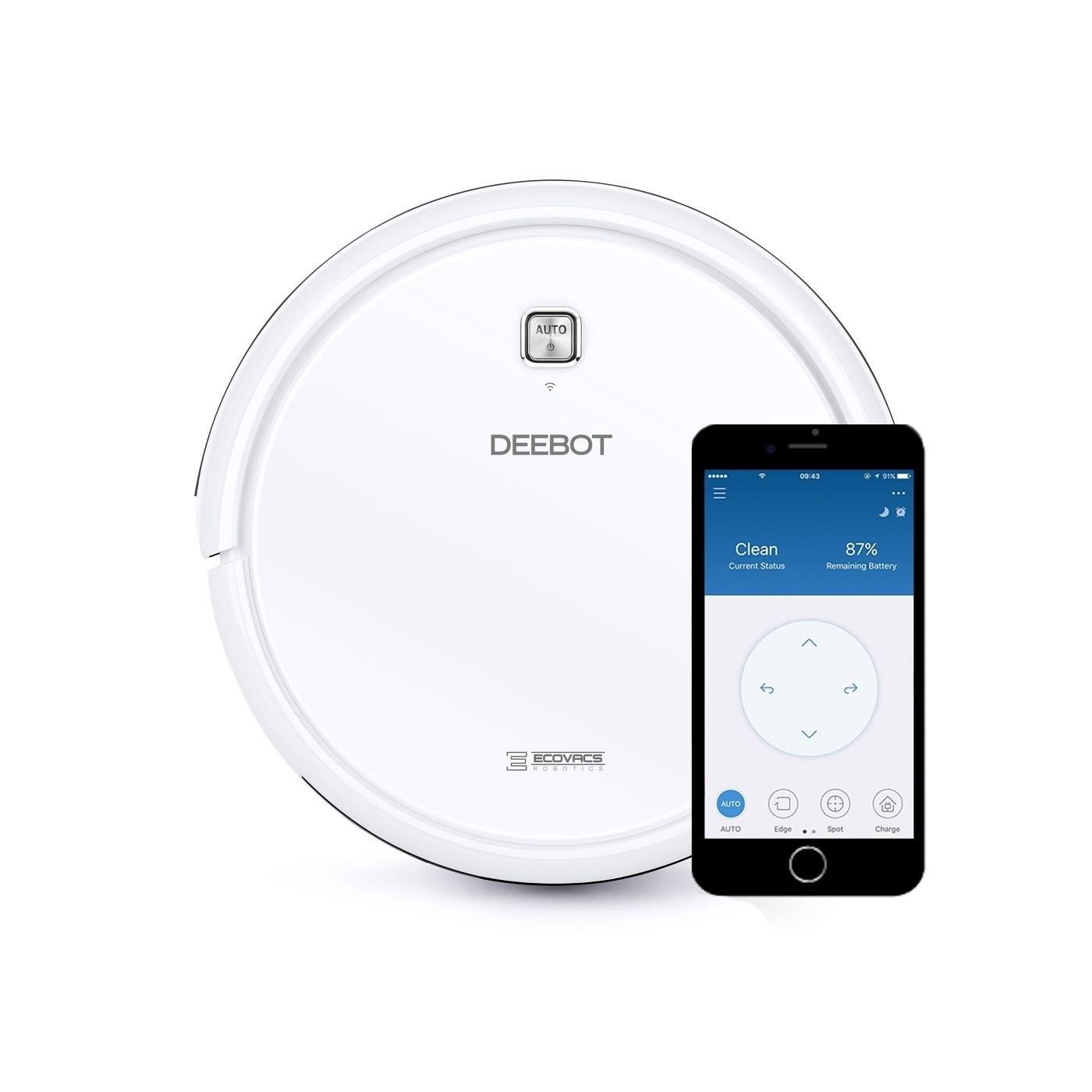 a white circular robot vacuum next to an iphone