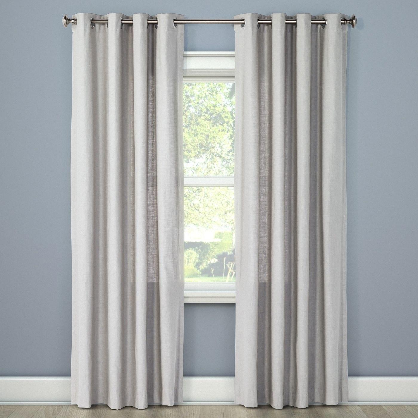 a set of light grey curtains
