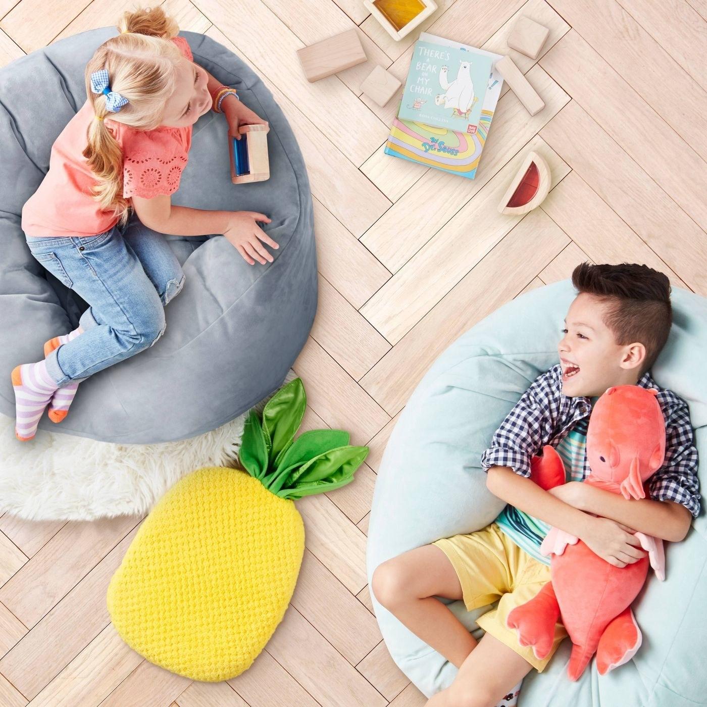 two children cuddling soft stuffed animals
