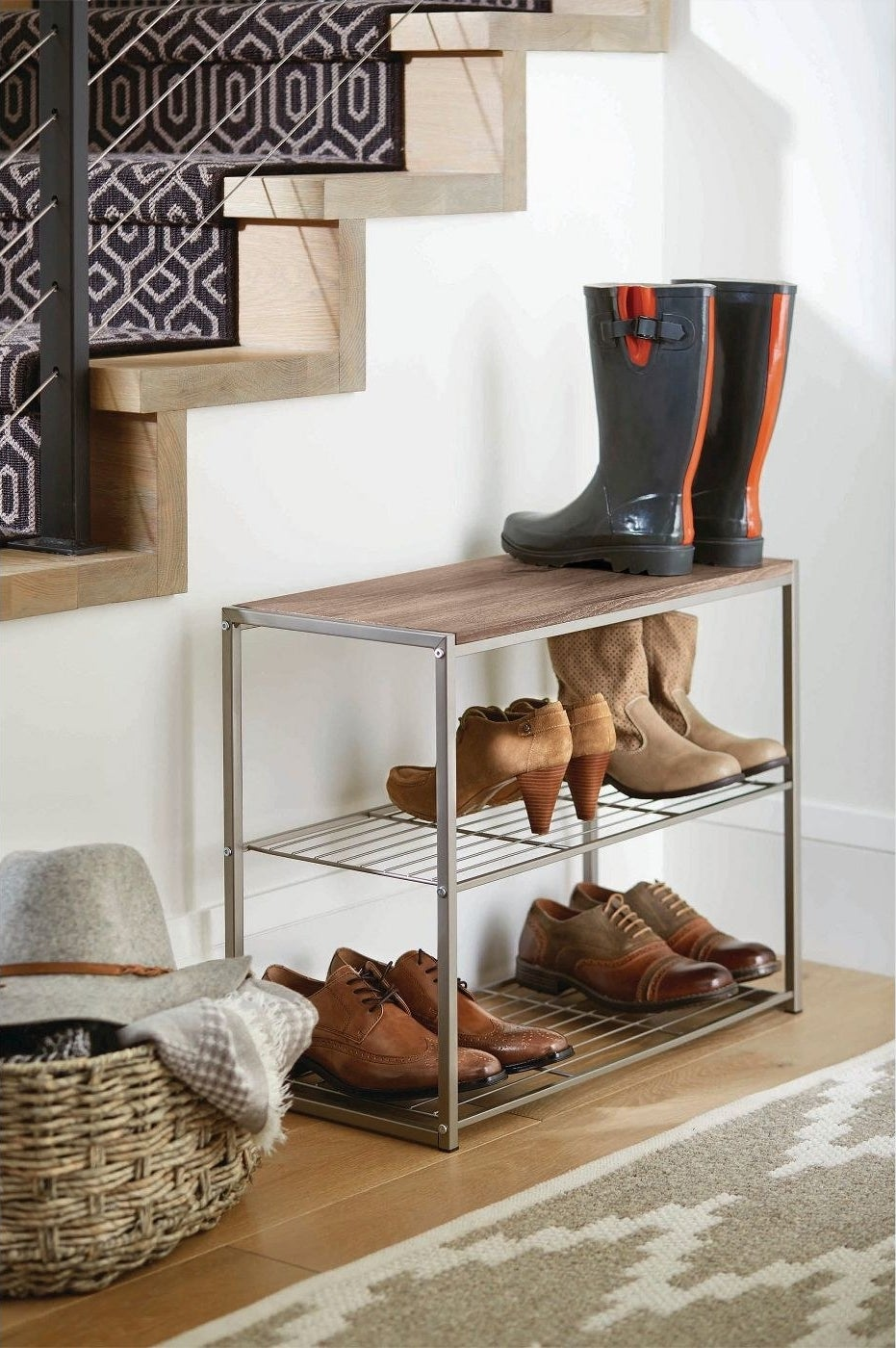 a three-tiered show rack with a wooden tabletop and grey metal bar sides