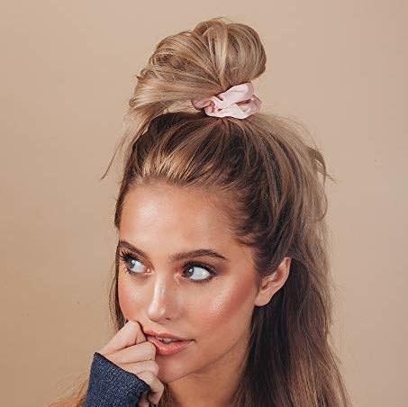 A model wearing pink scrunchie in hair