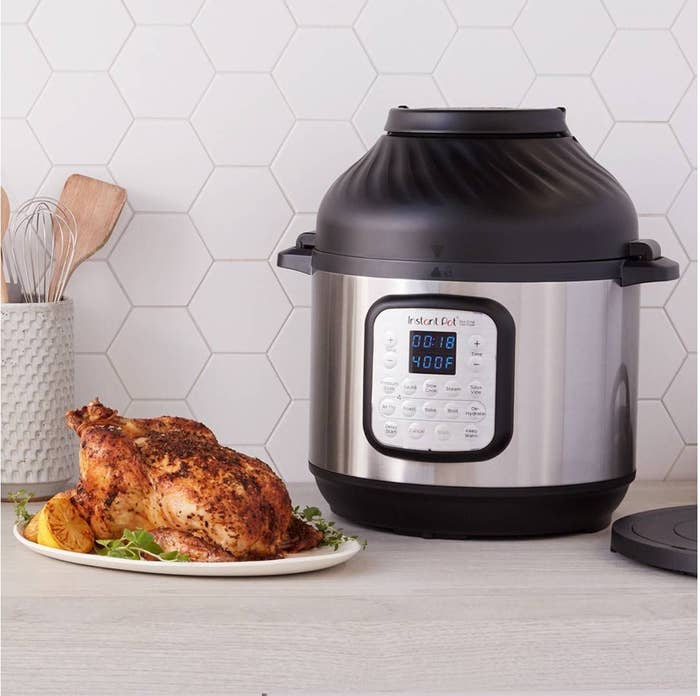 a silver instant pot with a black lid