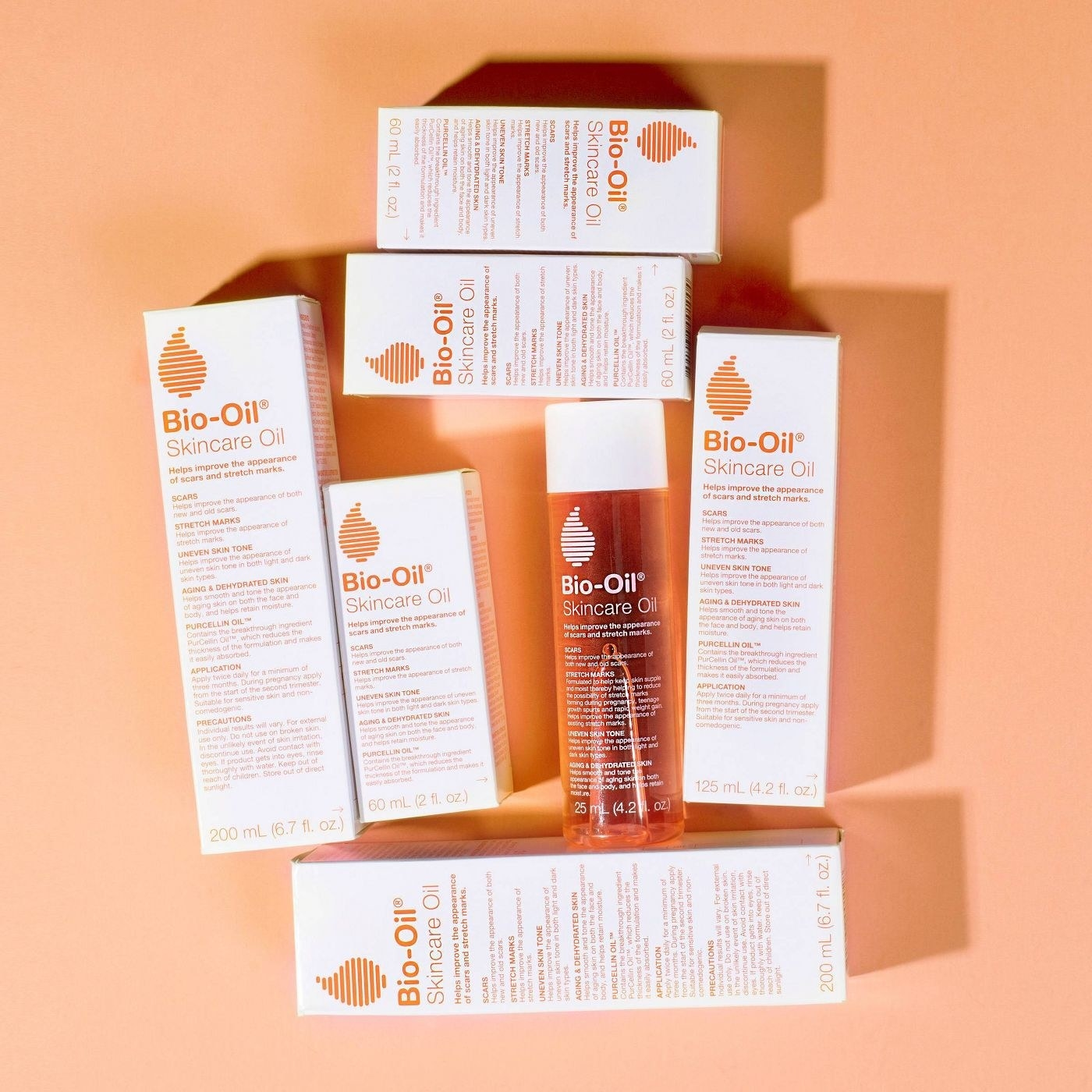 a bunch of boxes of the bio-oil