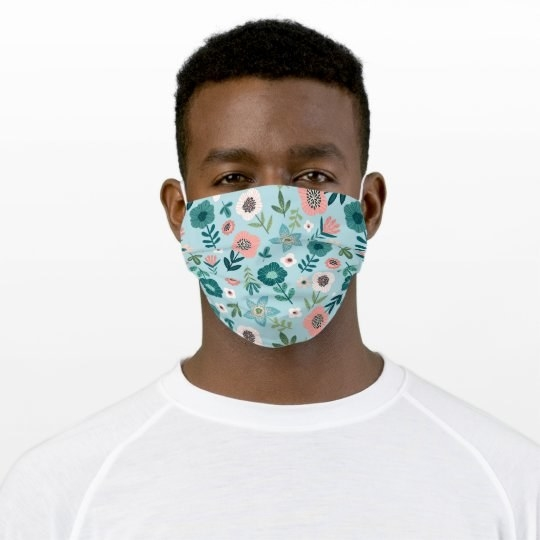 Model wearing a blue floral face mask