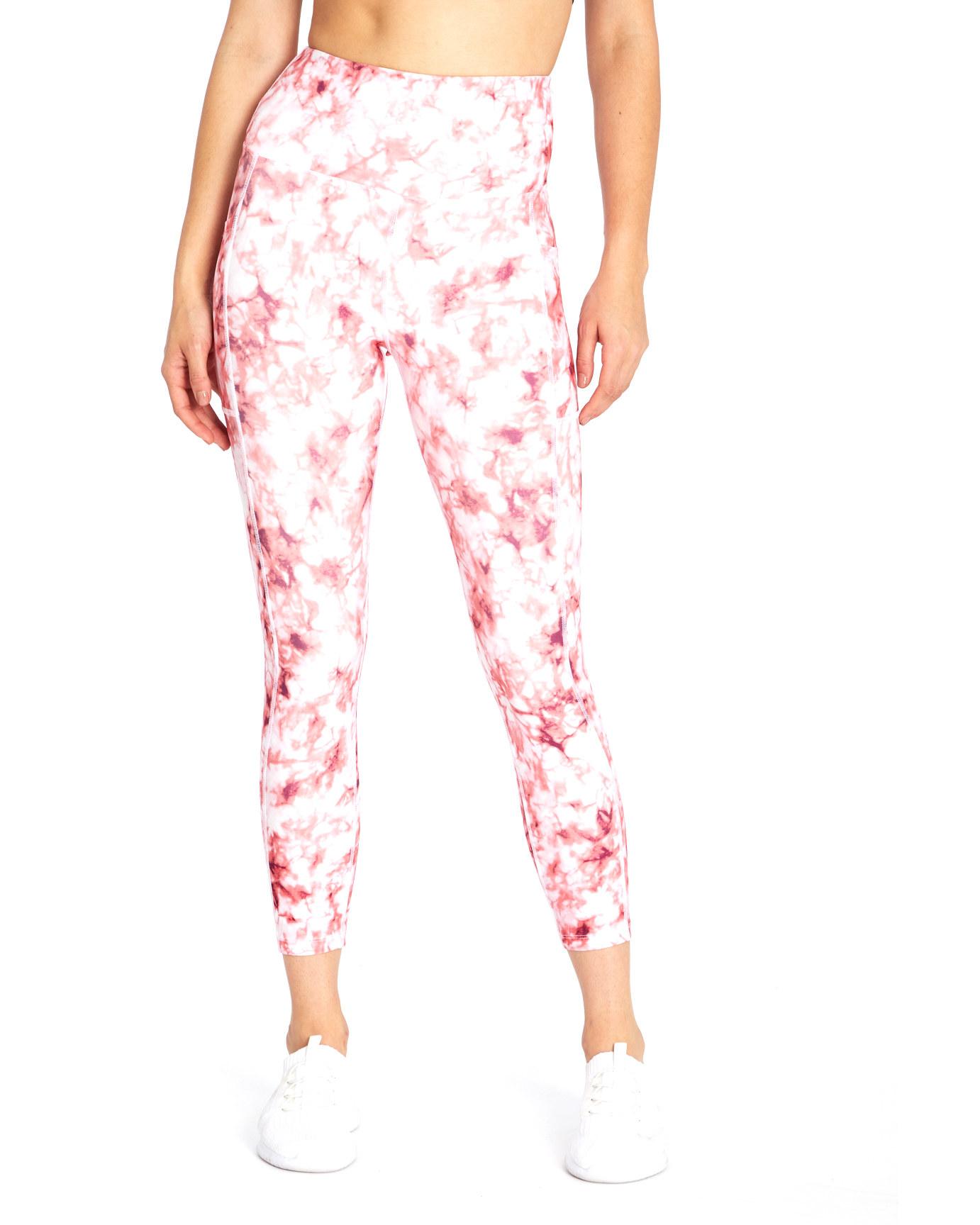 model wearing pink and white tie dye leggings