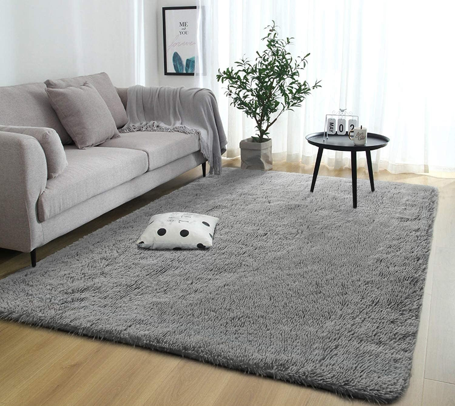 The rug in a living room with a table on top