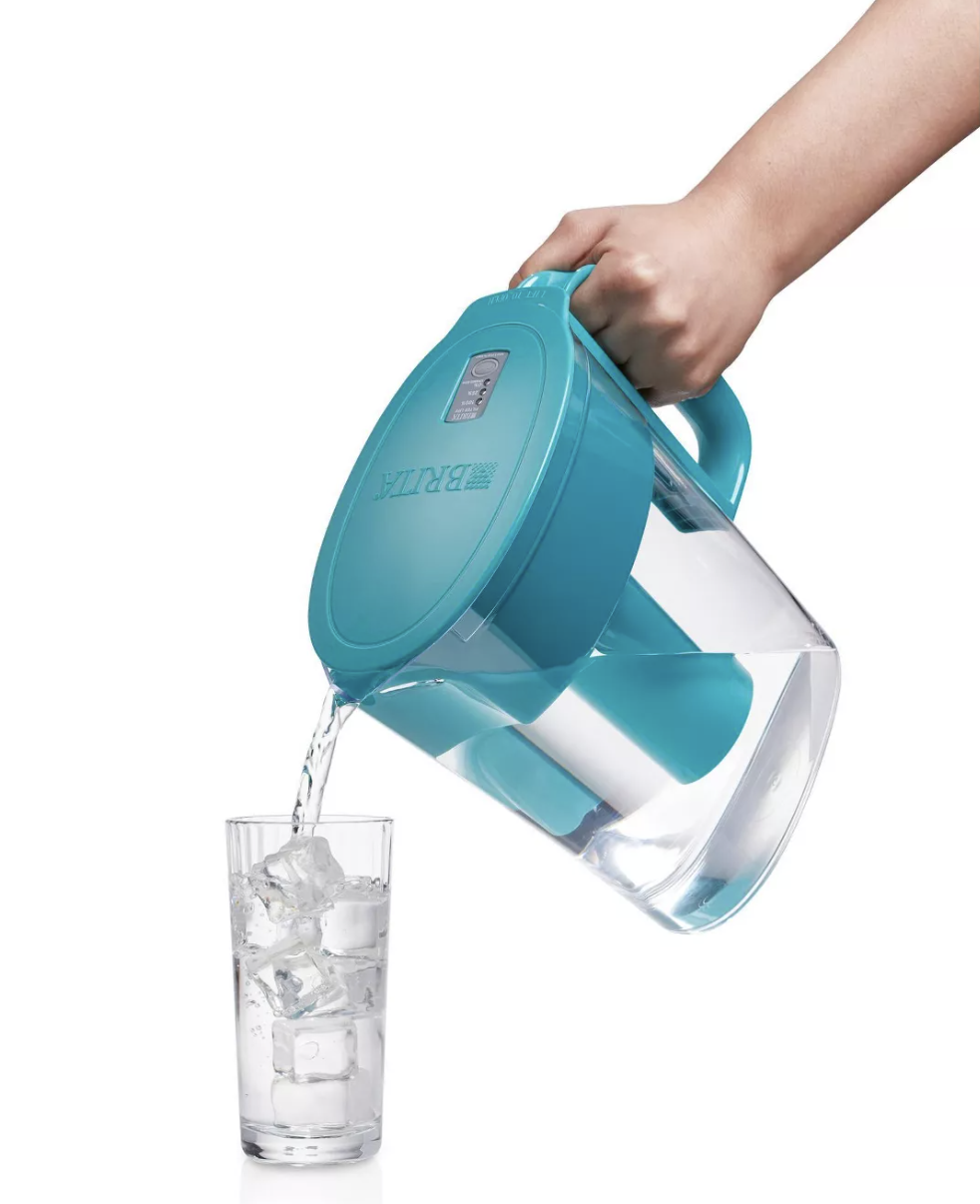a model pouring from a clear and turquoise brita pitcher