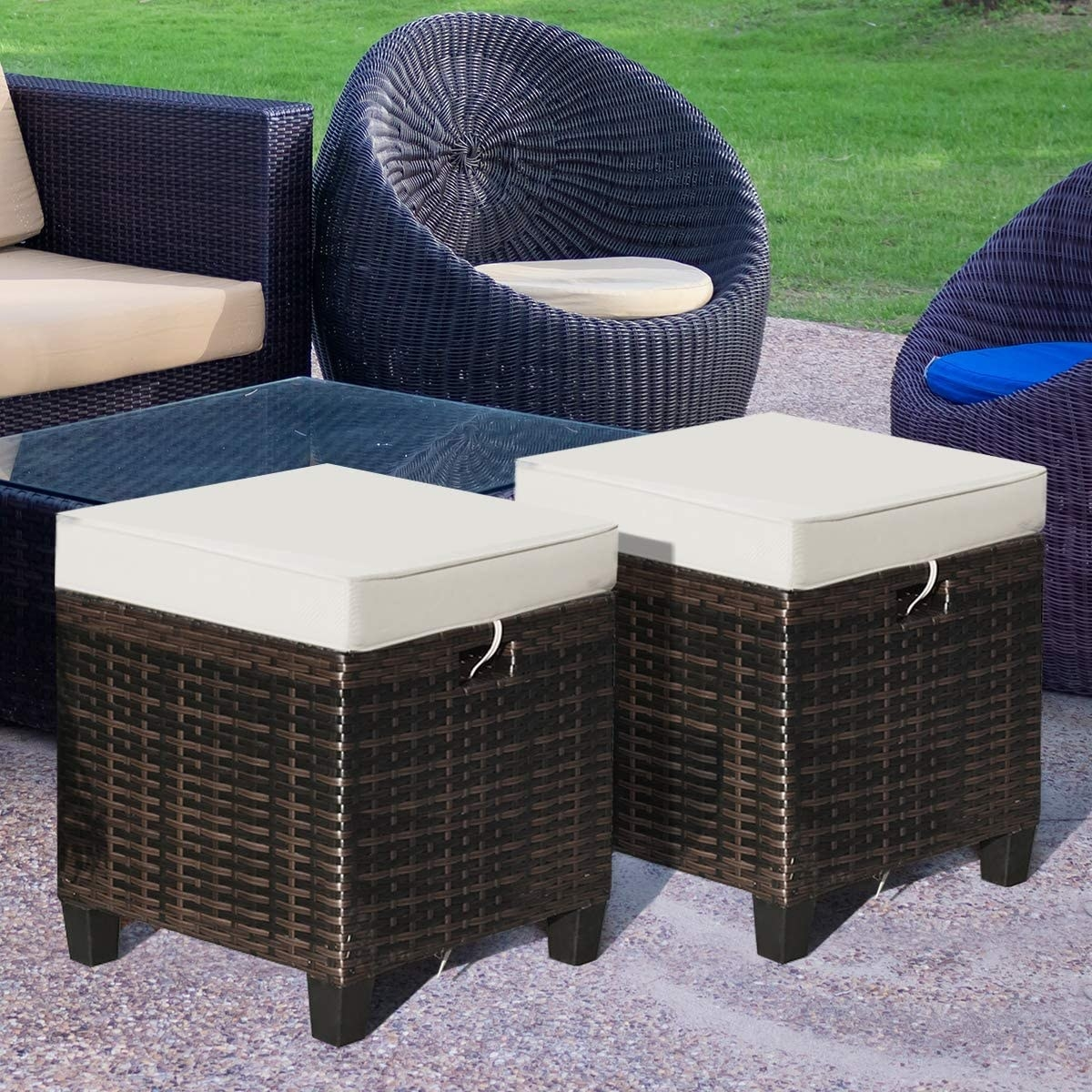 two brown wicker ottomans with tan cushions
