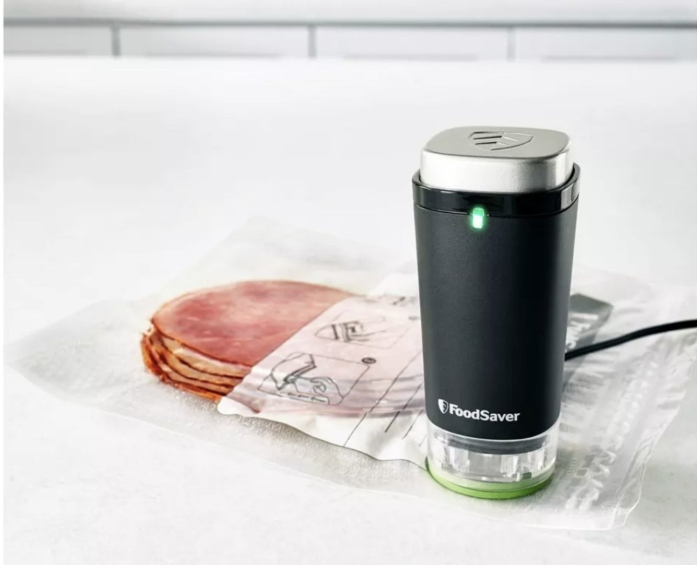 The vacuum device next to leftover food it suctioned air from the bag of
