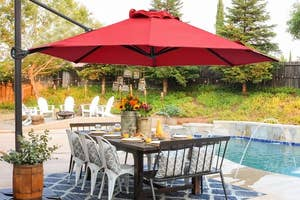 red offset umbrella over outdoor table