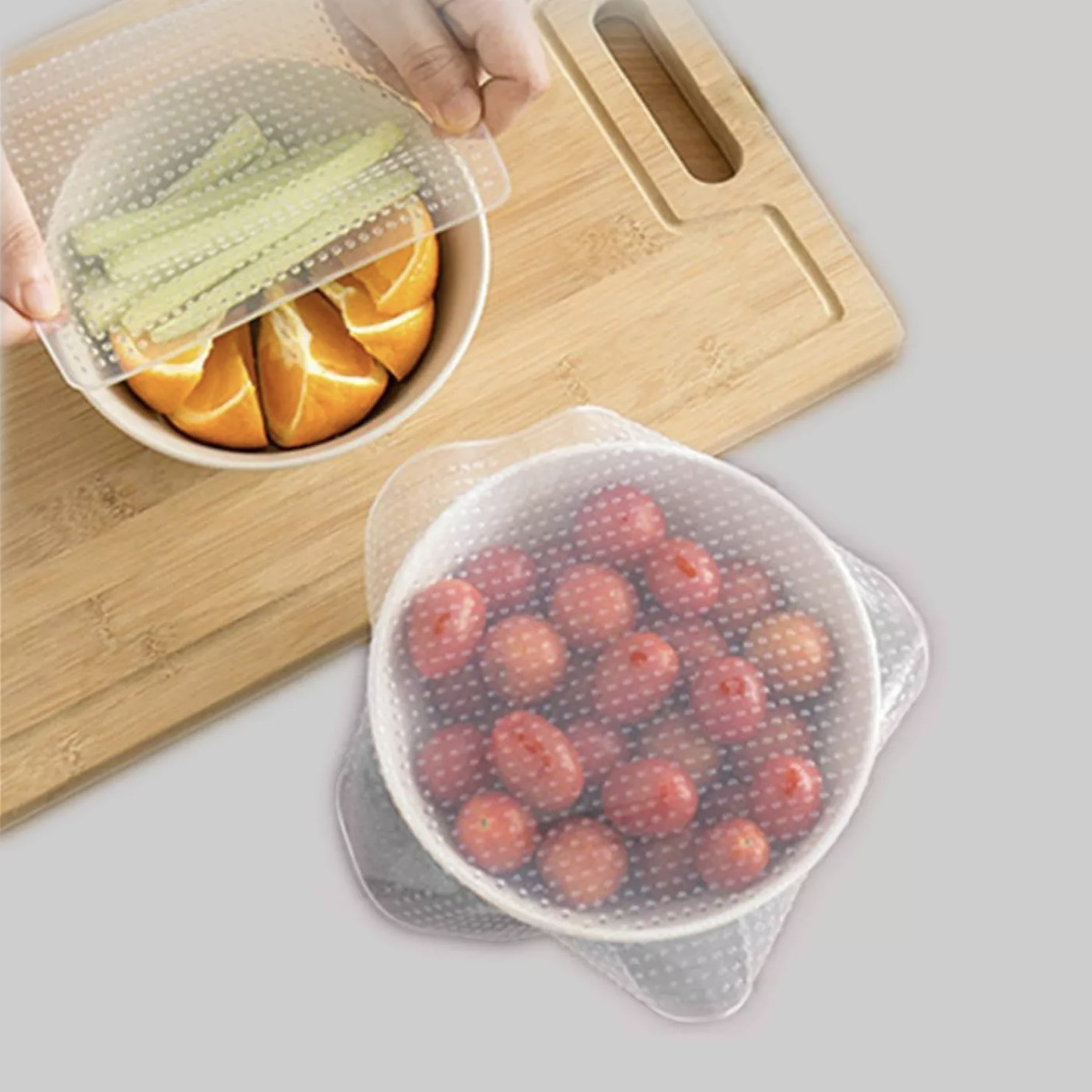 Transparent silicone lids stretched over bowls full of food