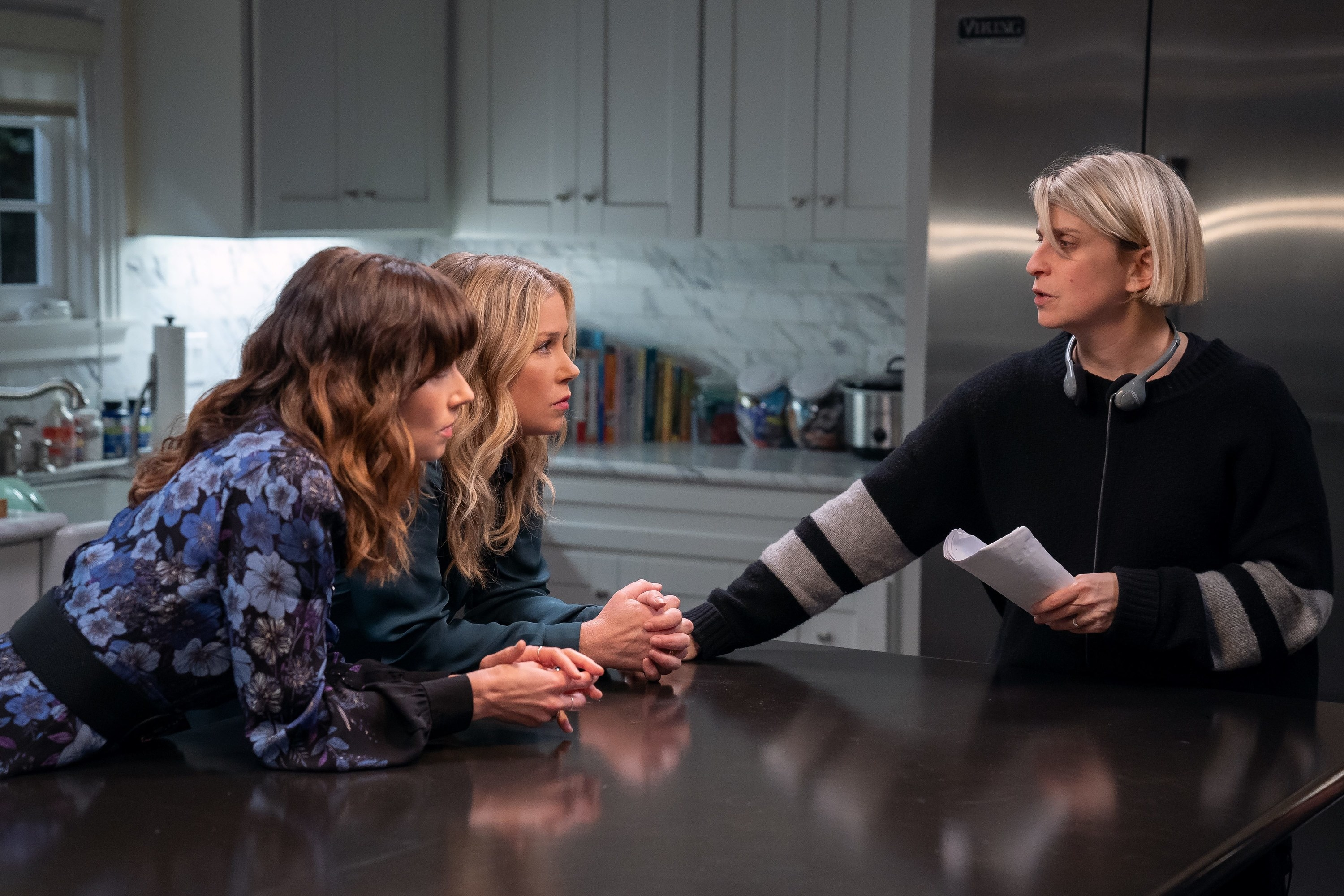 Liz talking to Christina and Linda on the set of Dead to Me Season 2