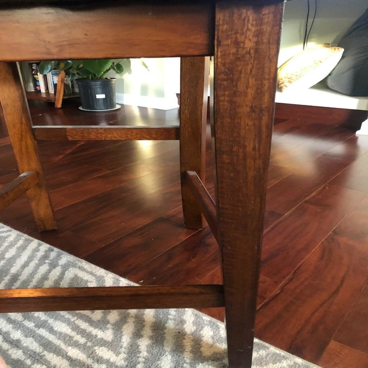 A reviewer showing the same chair leg with no visible scratch marks