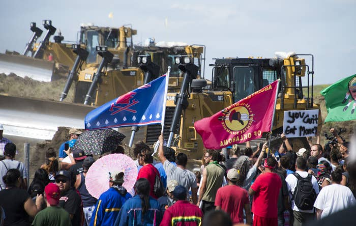 Protesters opposing the Dakota Access Pipeline confront bulldozers in September 2016.