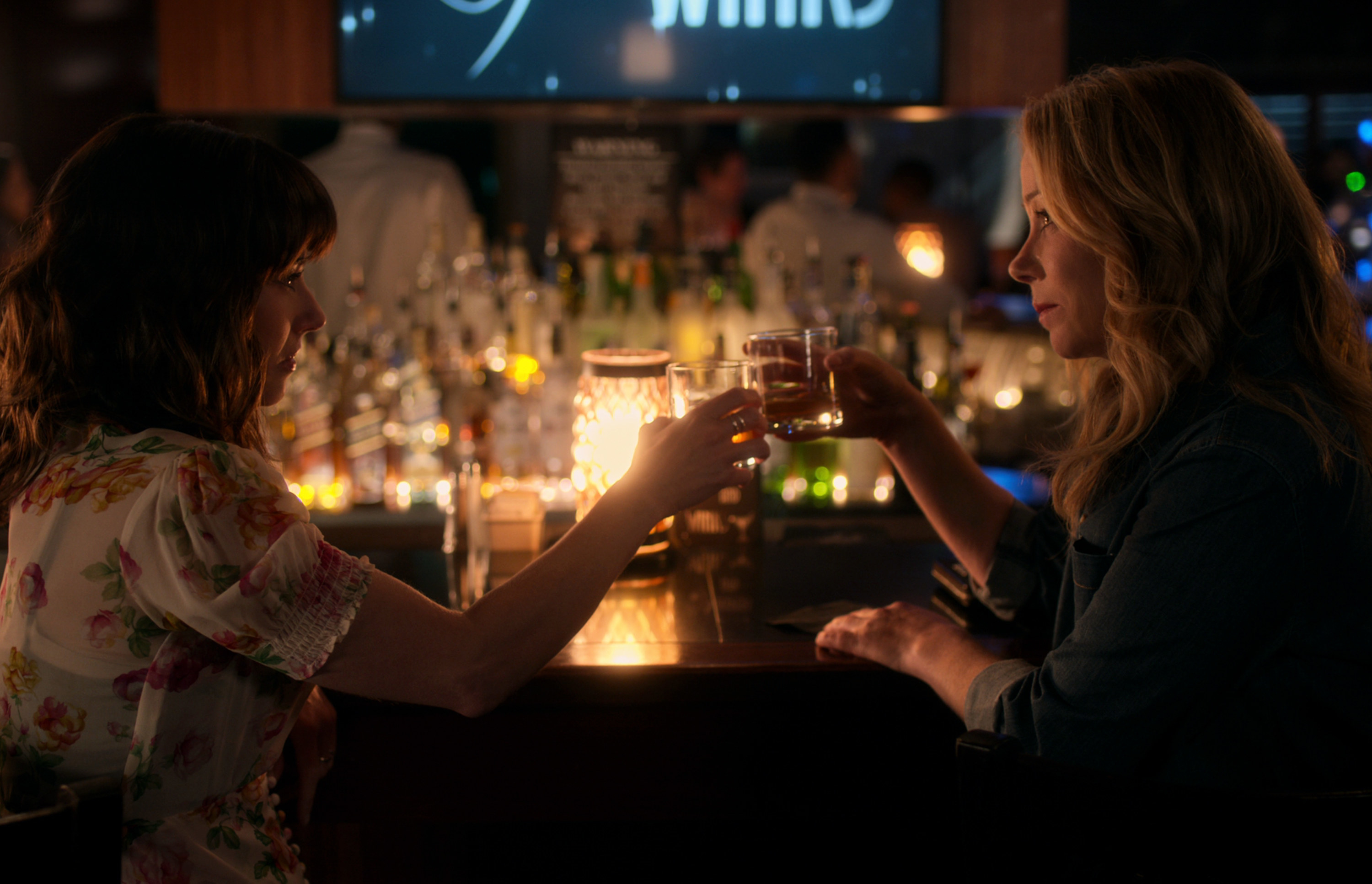Jen and Judy drinking together at a bar