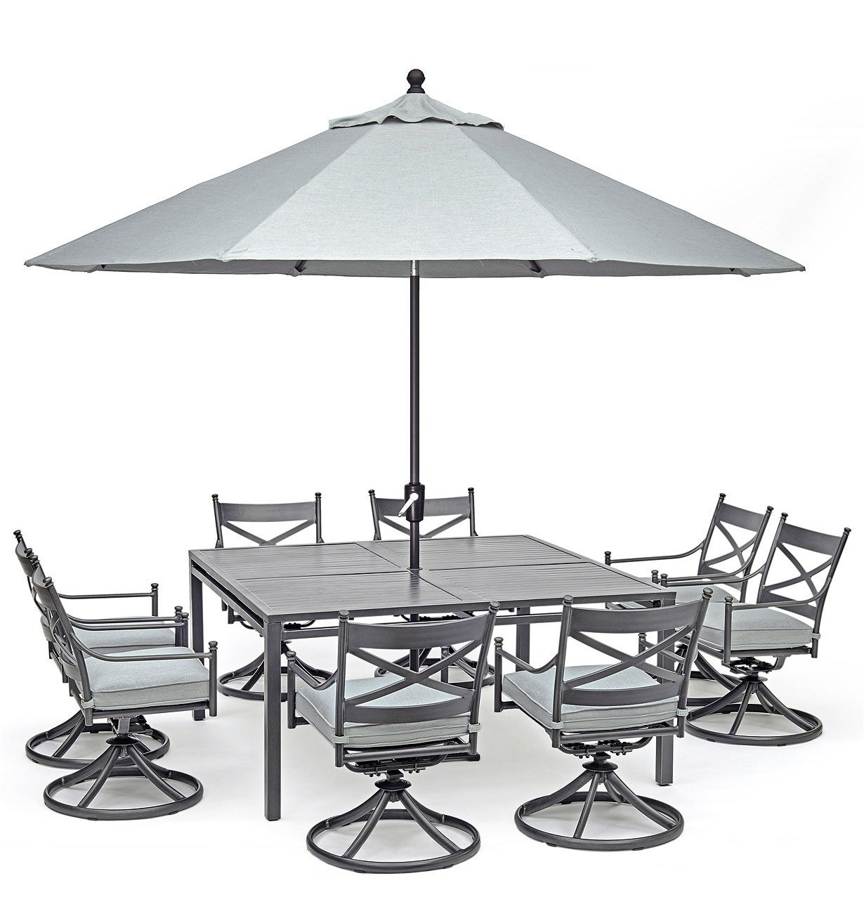 silver table with eight silver swivel chairs and a matching umbrella