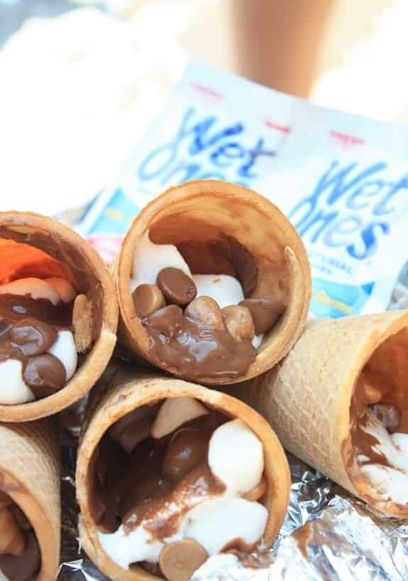 Five sugar cones filled with melted chocolate, peanut butter, and marshmallow.