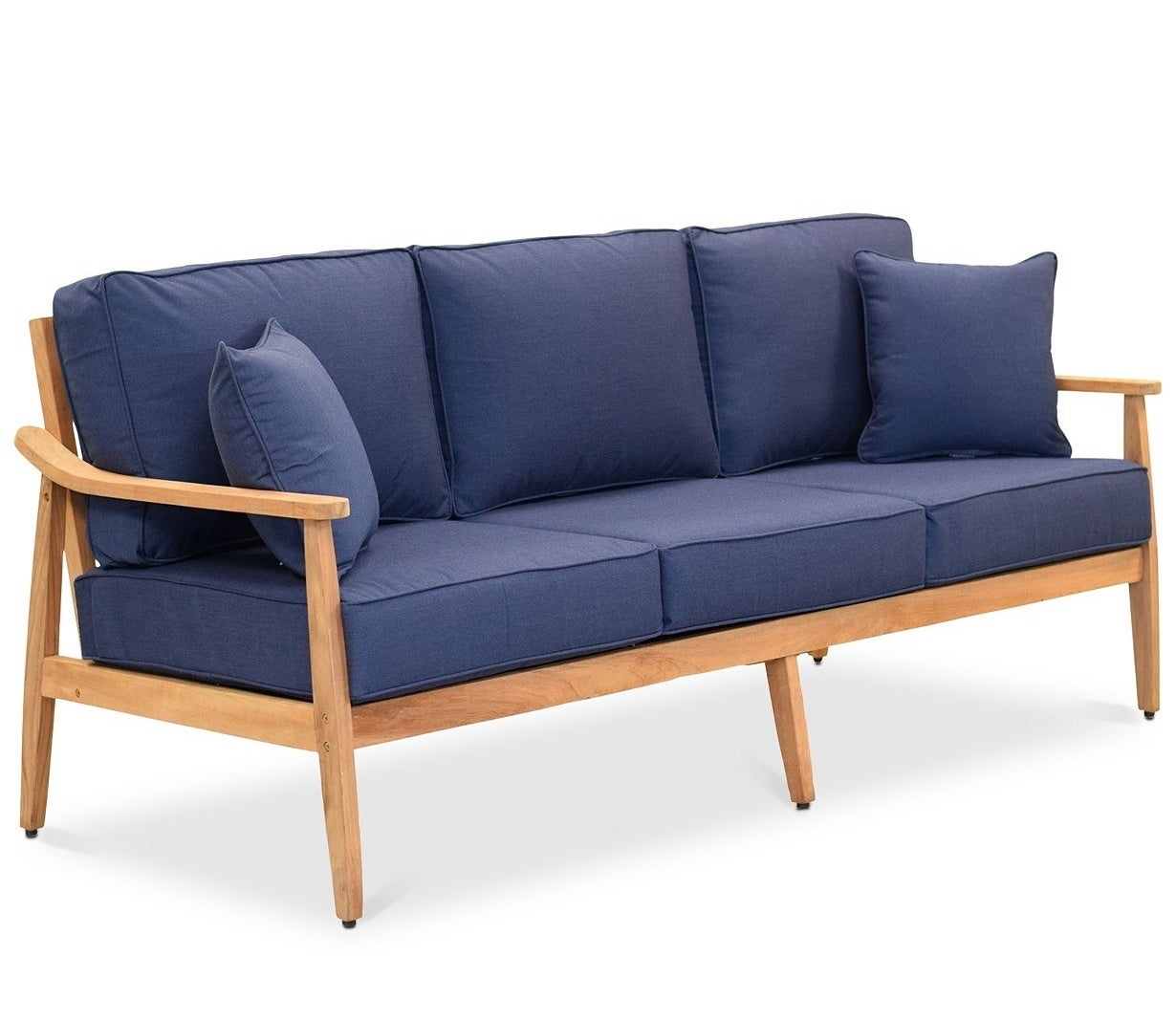 wood sofa frame with plush dark blue cushions and pillows
