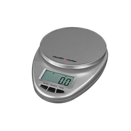 A small silver kitchen scale with a digital display
