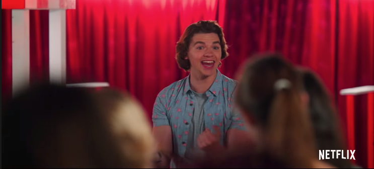 """Joel Courtney as Lee opening the kissing booth at the school fair in """"The Kissing Booth 2."""""""