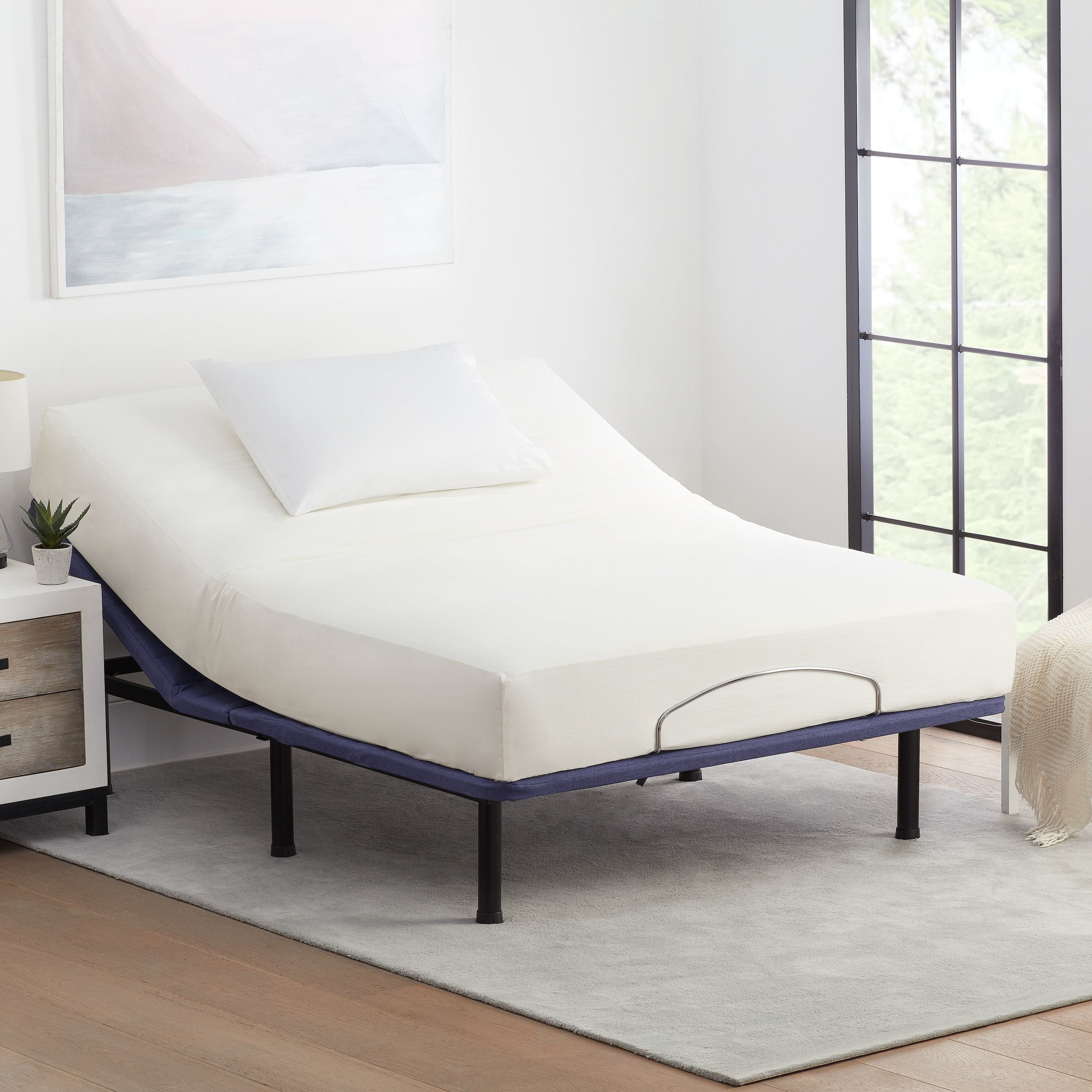 The bed frame with a mattress on it