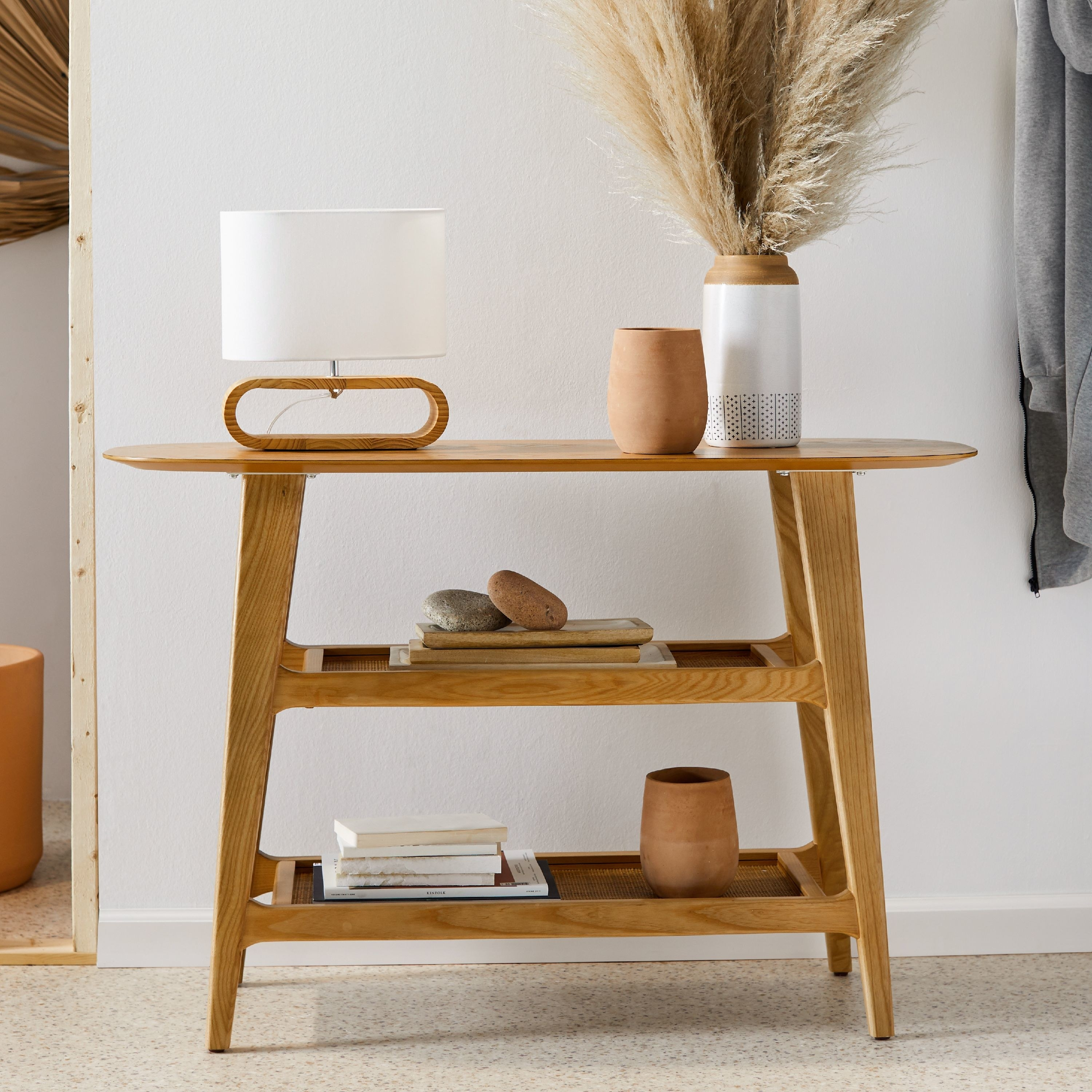A wooden console table with three shelves