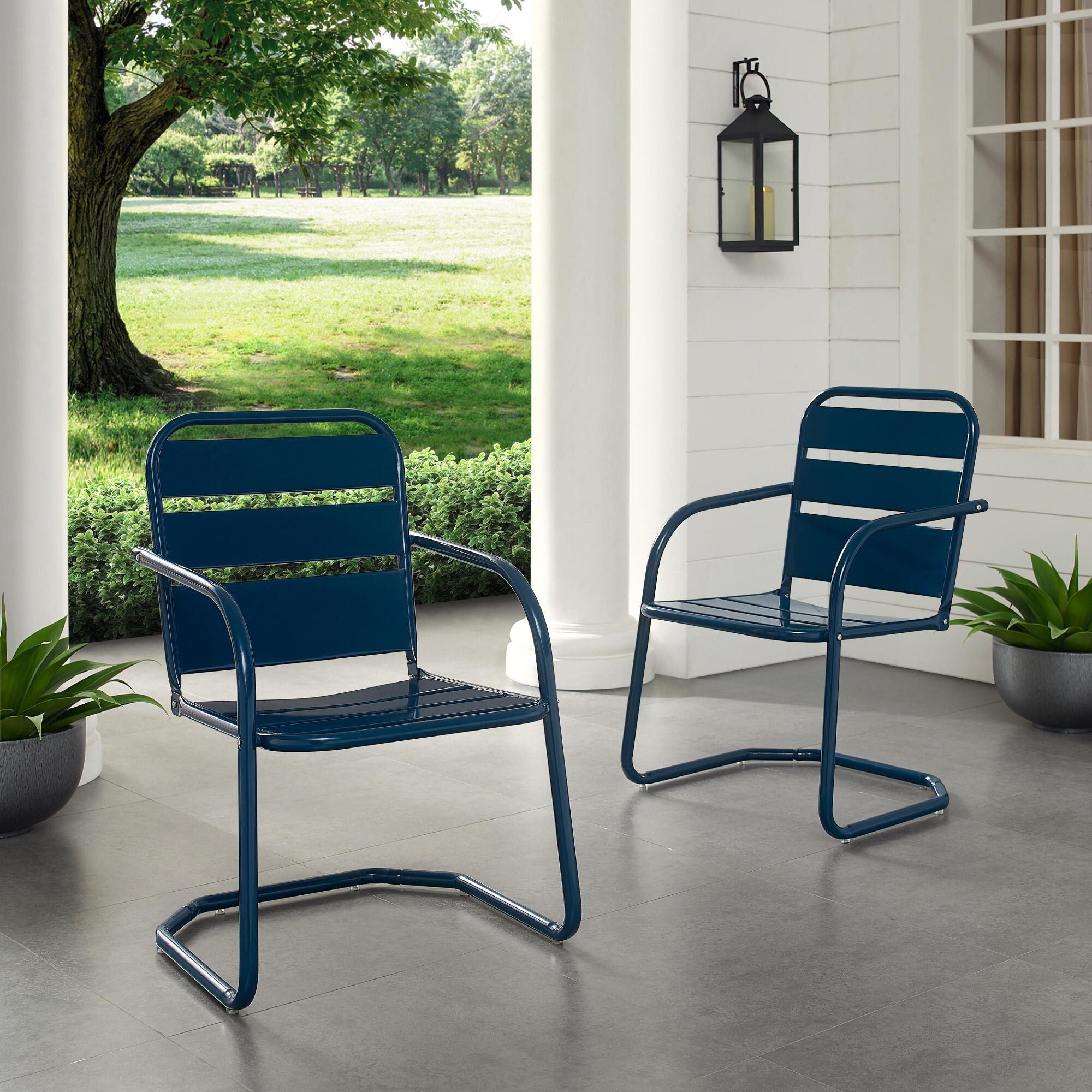 two navy metal chairs