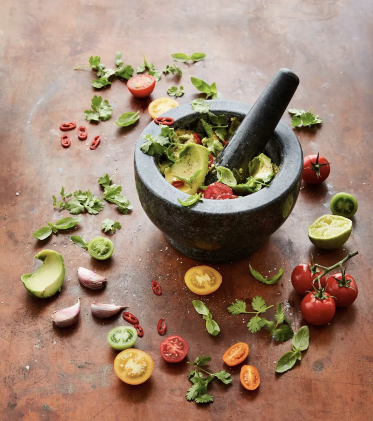 The mortar and pestle making fresh guac
