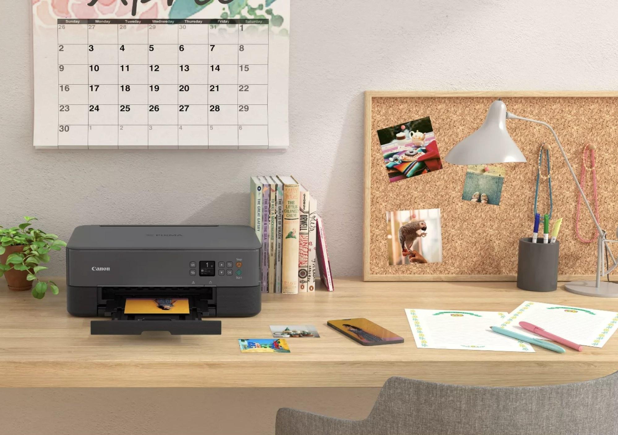 A black printer printing out a photograph