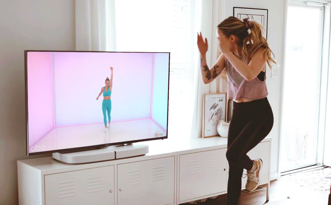 a model following a workout from their TV