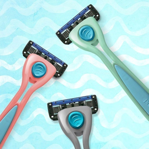 Three five-blade razors on a wavy background