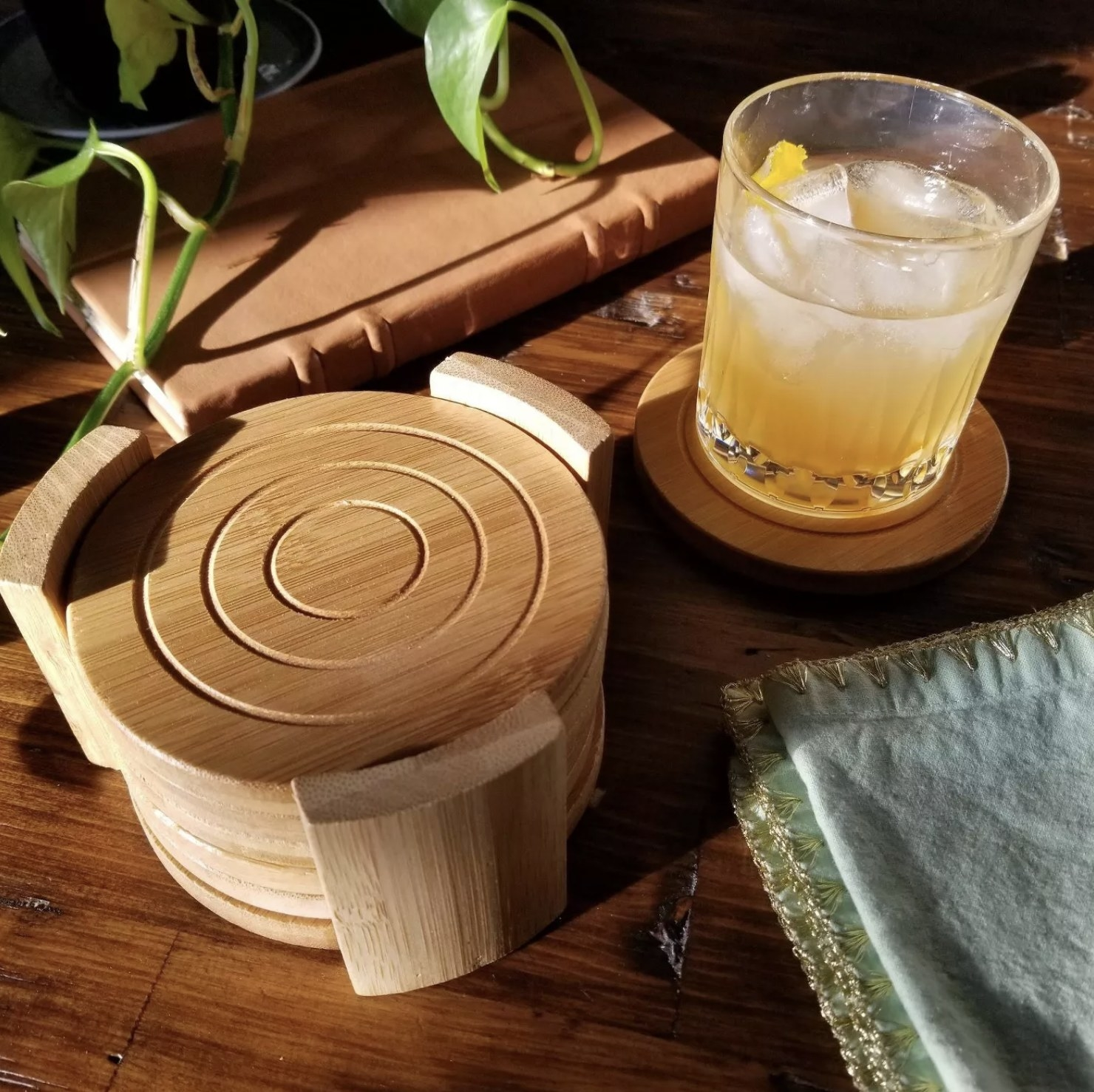 Four circular light wood bamboo coasters on a table