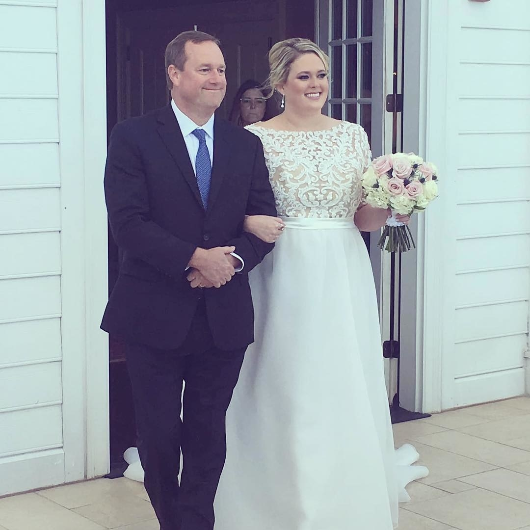 Photo of Jen with her father on her wedding.