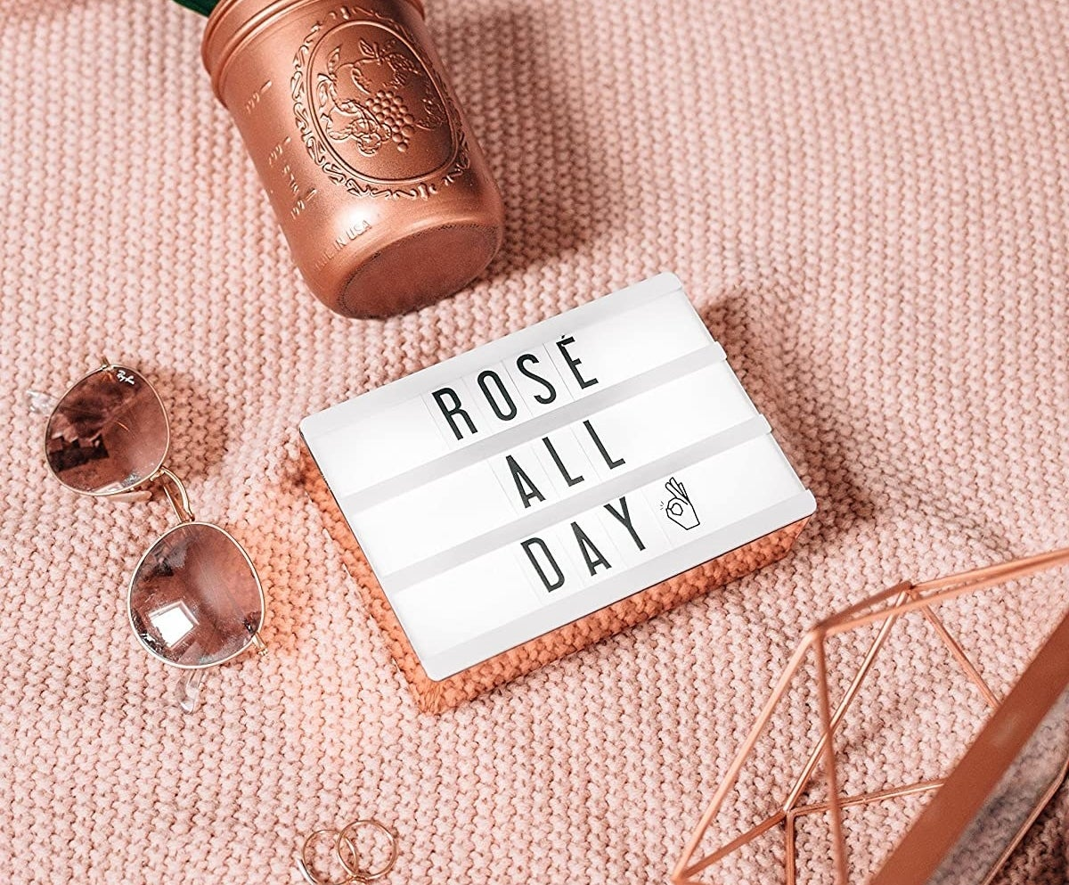 A rectangular cinema light box with the words rosé all day written on it