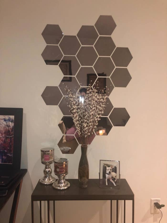 A reviewer's set of hexagon-shaped mirrors on the wall