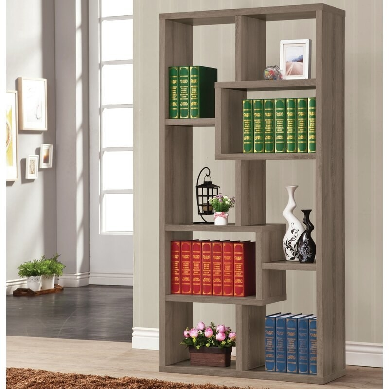 A dark-gray bookshelf with eight shelf spaces
