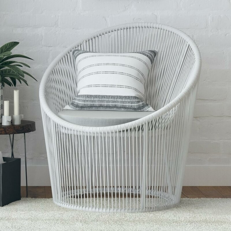 white vertically structured wicker round chair with cushions