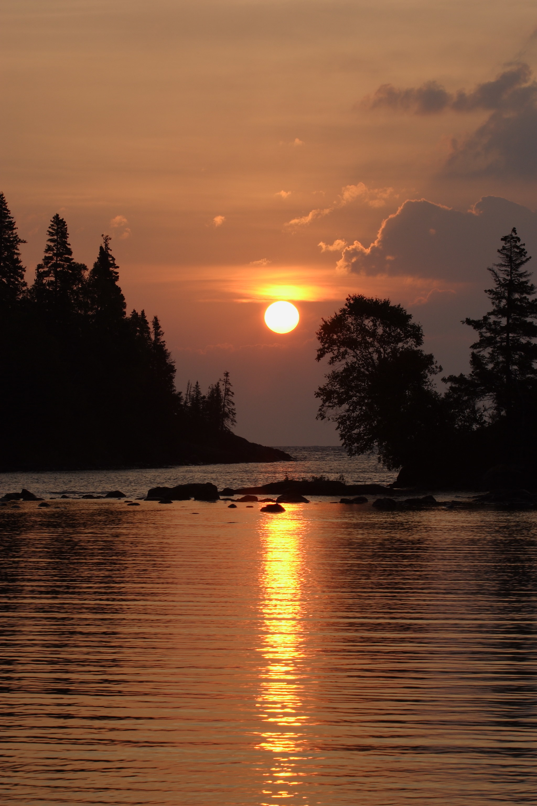 The sun setting over a lake in Isle Royale National Park.