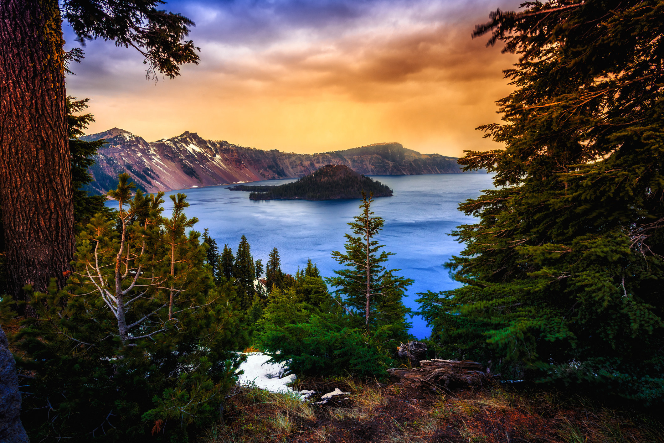 A colorful sunset over Crater Lake in Crater Lake National Park.