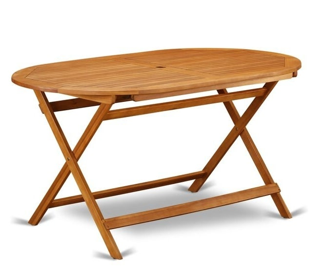 wood cylindrical dining table with a hole for an umbrella