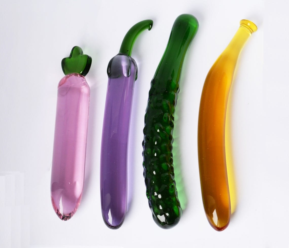 glass dildos shaped like a radish, eggplant, cucumber, and banana