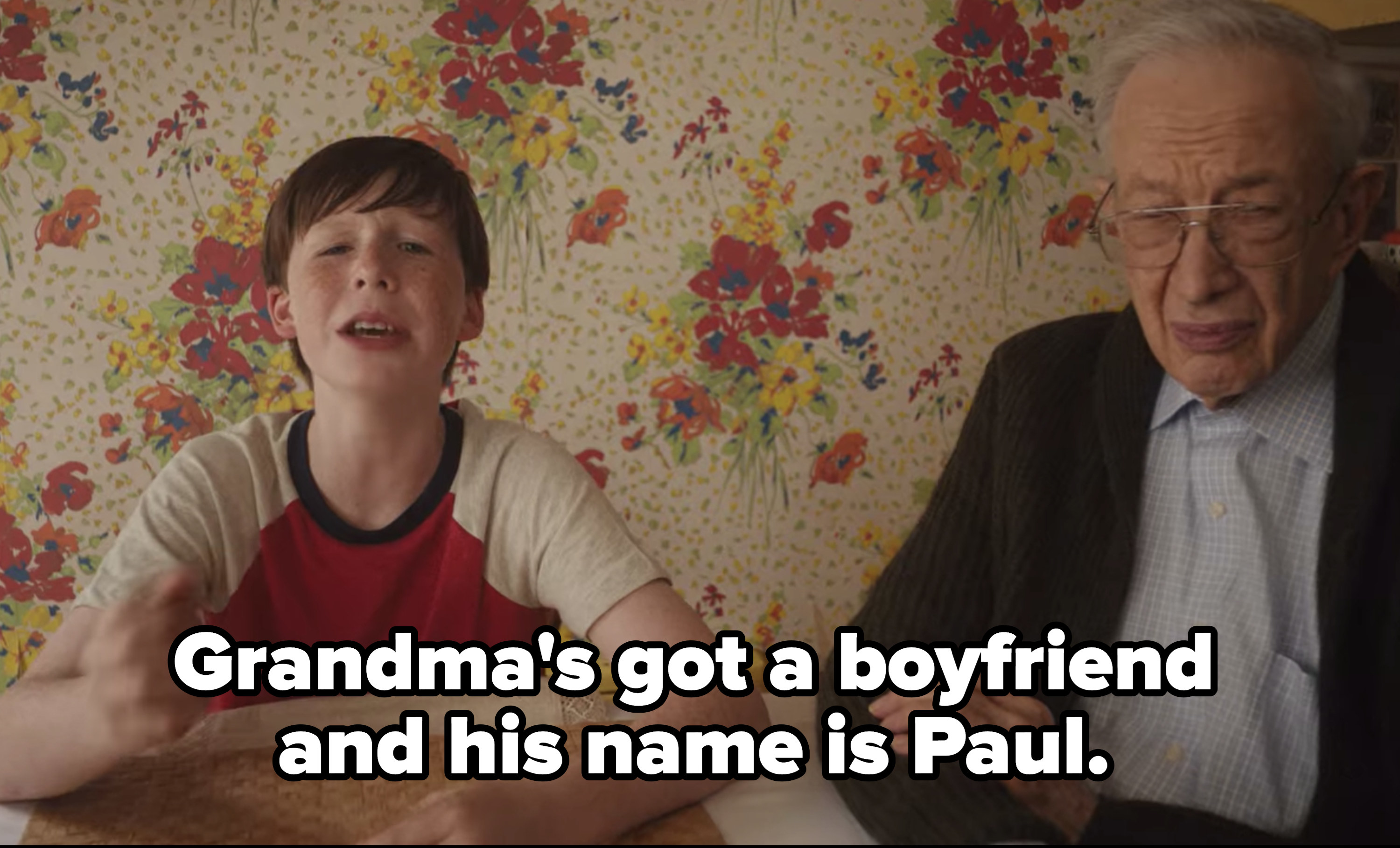 "Kid sitting next to grandma's boyfriend singing ""Grandma's got a boyfriend and his name is Paul."""